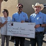 Photo of $50,000 check to Second Harvest for Wrap Up promo